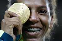 Brazil_s_Rafaela_Silva_celebrates_after_receiving_the_gold_